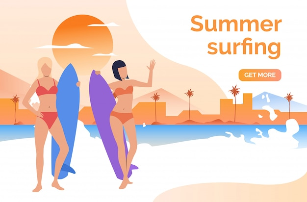 Dos chicas en bañadores con tablas de surf.