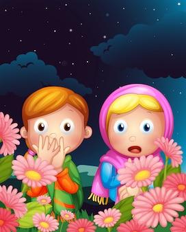 Dos chicas escondidas en medio de la noche.