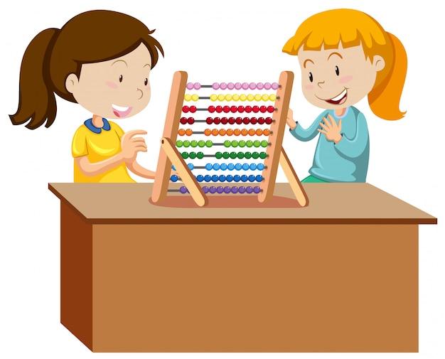 Dos chicas jóvenes jugando con un ábaco