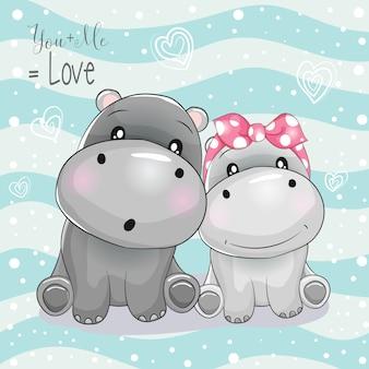 Dos dibujos animados de hipopótamos lindos sobre fondo de rayas