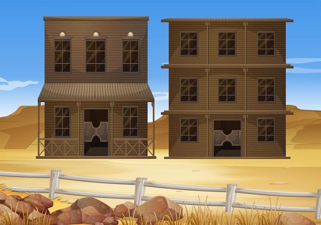 Dos edificios en el suelo del desierto.
