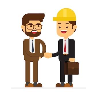 Dos hombre de negocios que habla y sacude la mano