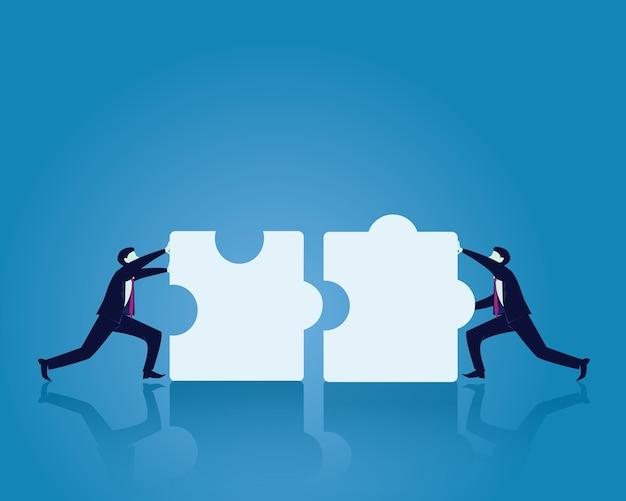 Dos hombre de negocios trabajando para unir rompecabezas juntos