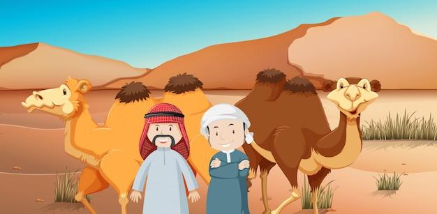 Dos hombres árabes y camellos en tierra desértica.