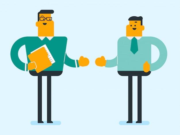 Dos hombres de negocios confiados blancos caucásicos hablando.