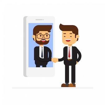 Dos hombres de negocios se dan la mano en la pantalla del teléfono inteligente