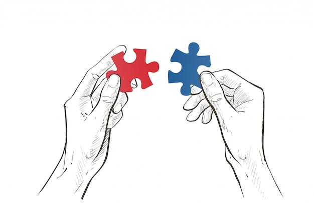 Dos manos conectan la pieza jigsaw puzzle.