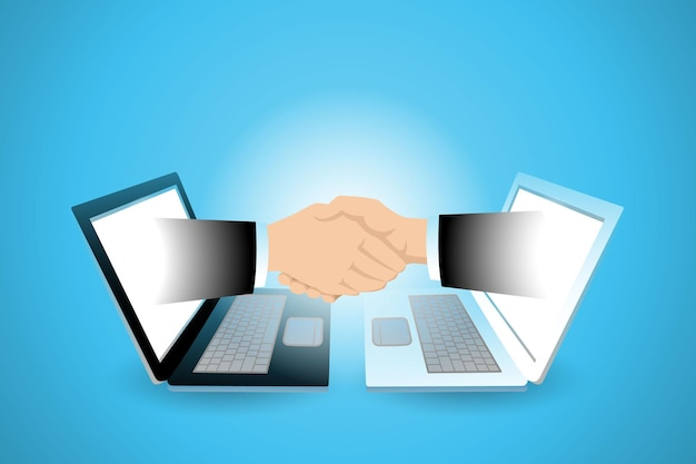 Dos manos de hombre de negocios que aparecen desde el portátil y un apretón de manos