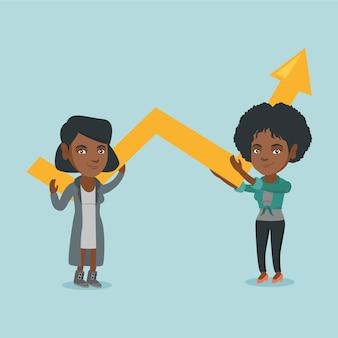 Dos mujeres de negocios jóvenes con gráfico de crecimiento.