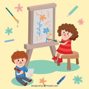 Dos niños bonitos pintando