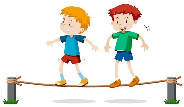 Dos niños en cuerda de equilibrio