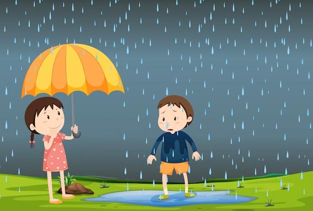 Dos niños bajo la lluvia