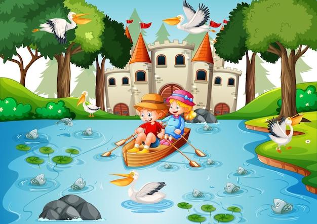 Dos niños reman el bote en la escena del parque del río.