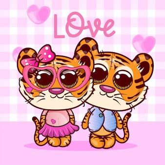 Dos pequeños dibujos animados lindos de los tigres con el corazón. vector