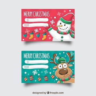 Dos tarjetas de feliz navidad con un muñeco de nieve y un reno