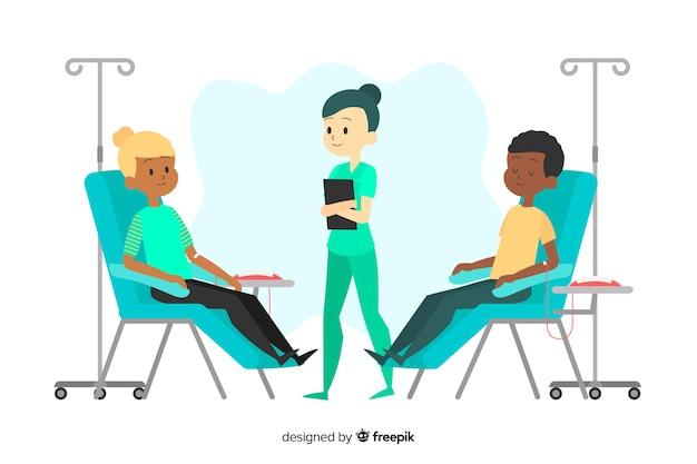 Dos voluntarios que donan sangre en presencia de una enfermera
