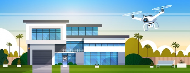 Drone moderno vuela sobre la construcción de viviendas con caja, transporte aéreo y concepto de tecnología de entrega
