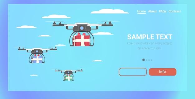 Drones entregando cajas de regalo presente cielo transporte envío correo aéreo entrega urgente concepto navidad vacaciones celebración
