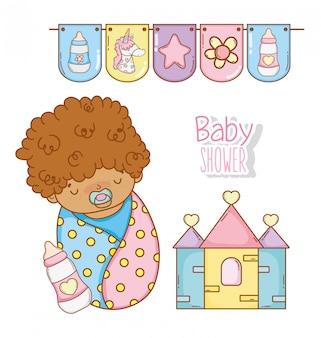 Ducha de bebé con biberón y casa.