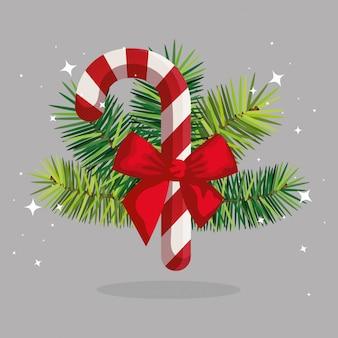 Dulce bastón de navidad con lazo de cinta y hojas