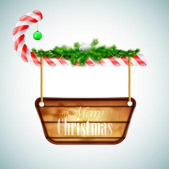 Dulces de navidad con tablero de madera.