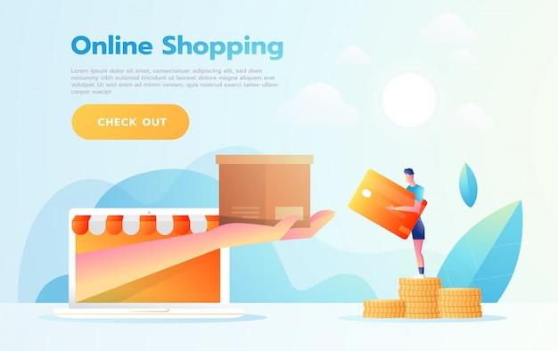 E-commerce o concepto de compras en línea con las manos que alcanzan desde una pantalla de computadora sosteniendo un producto de compras.