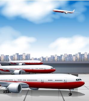 Edificio del aeropuerto con estacionamiento de aviones.