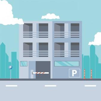 Edificio con entrada de zona de aparcamiento y barricada.