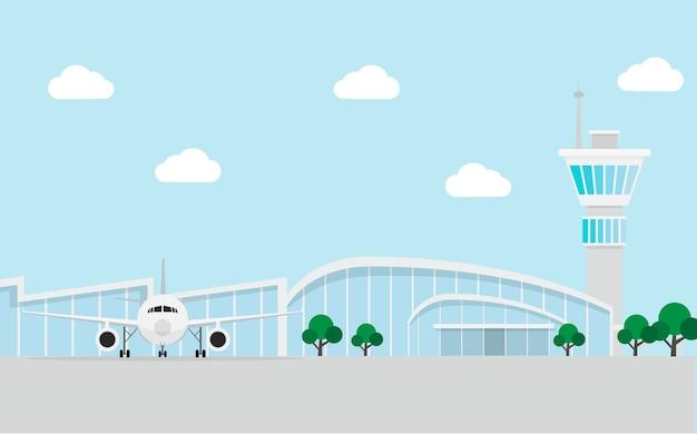 Edificio de la terminal del aeropuerto con avión y torre de control de tráfico aéreo.