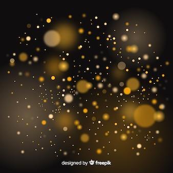 Efecto bokeh flotante de partículas doradas
