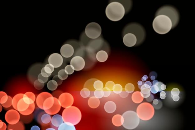 Efecto de luces bokeh sobre fondo oscuro
