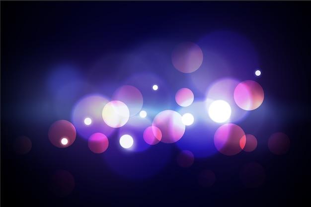 Efecto de luces bokeh sobre el tema del fondo de pantalla oscuro