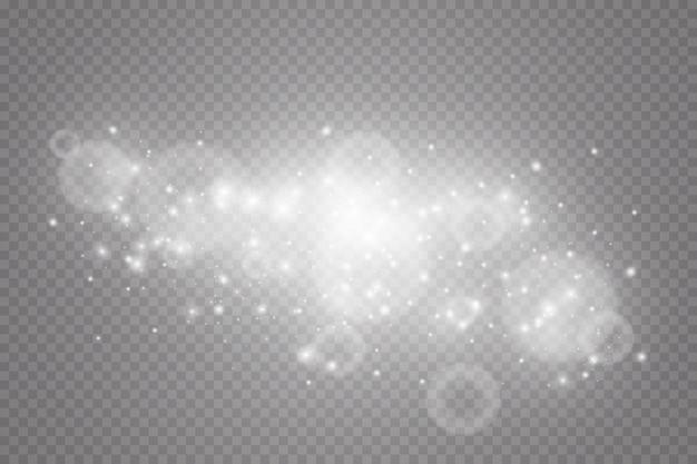 Efecto de luz especial chispas y purpurina. destellos sobre fondo transparente. partículas de polvo mágico espumoso
