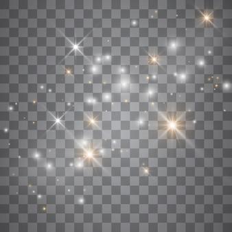 Efecto de luz resplandor estrellas. destellos sobre fondo transparente. patrón abstracto de navidad. brillantes partículas de polvo mágico.