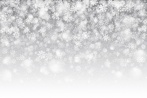 Efecto de nieve caída realista de navidad con copos de nieve blancos superpuestos sobre fondo plateado claro