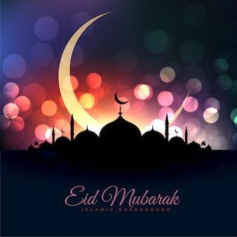 Eid al fitar hermosa mezquita y luna bokeh saludo.