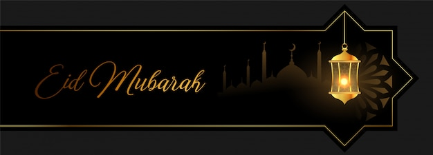 Eid mubarak banner dorado con linterna y mezquita