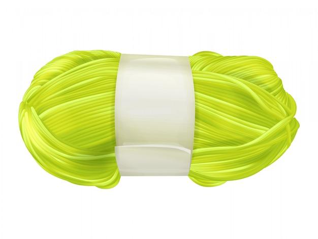 Ejemplo del ovillo de las lanas del hilado del hilo amarillo o verde de la materia textil que hace punto para tejer
