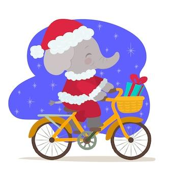 Elefante navideño en bicicleta