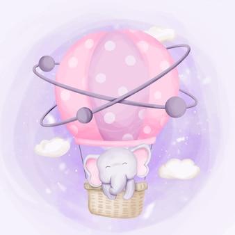 Elefante volando hacia el cielo con globo aerostático
