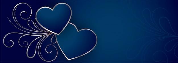 Elegante bandera de corazones de san valentín azul