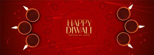 Elegante bandera roja feliz diwali con decoración diya