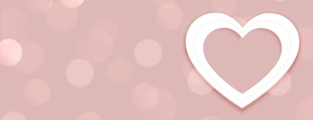 Elegante corazón blanco en banner bokeh con espacio de texto