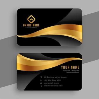 Elegante diseño ondulado de tarjetas de visita doradas y negras.