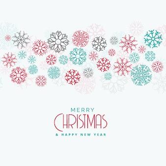 Elegante fondo de navidad con coloridos copos de nieve que fluye