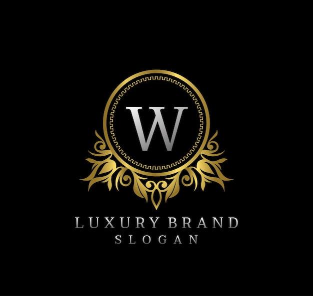 Elegante insignia de oro floral letra w diseño de logotipo