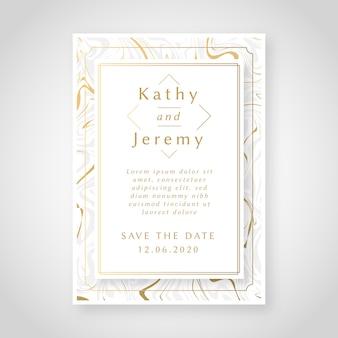 Elegante invitación de boda de mármol con detalles dorados.