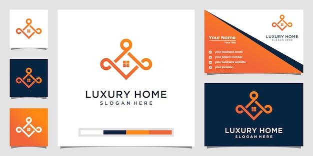 Elegante logotipo de bienes raíces de lujo y tarjeta de visita.