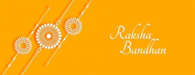 Elegante pancarta amarilla raksha bandhan con rakhi