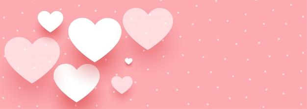 Elegante pancarta del día de san valentín con corazones blancos